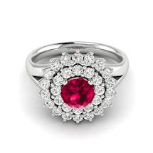 5.5mm Ruby surrounded with 30 Diamond Halo on 18k White Gold Band