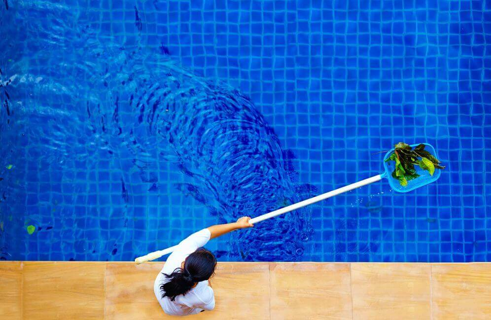 Cleaning a pool to make it sparkling clean