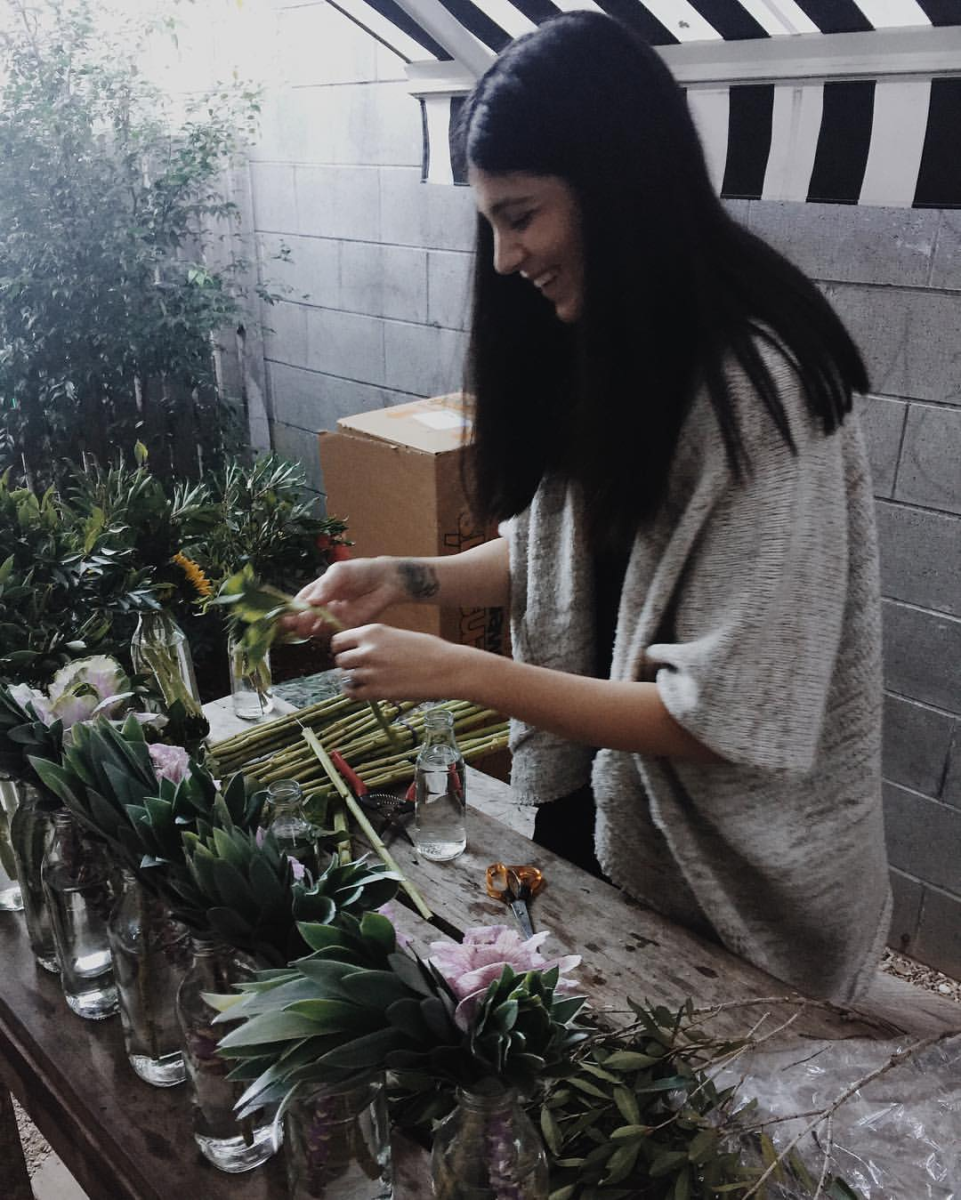 Ness creating works of art with her flowers