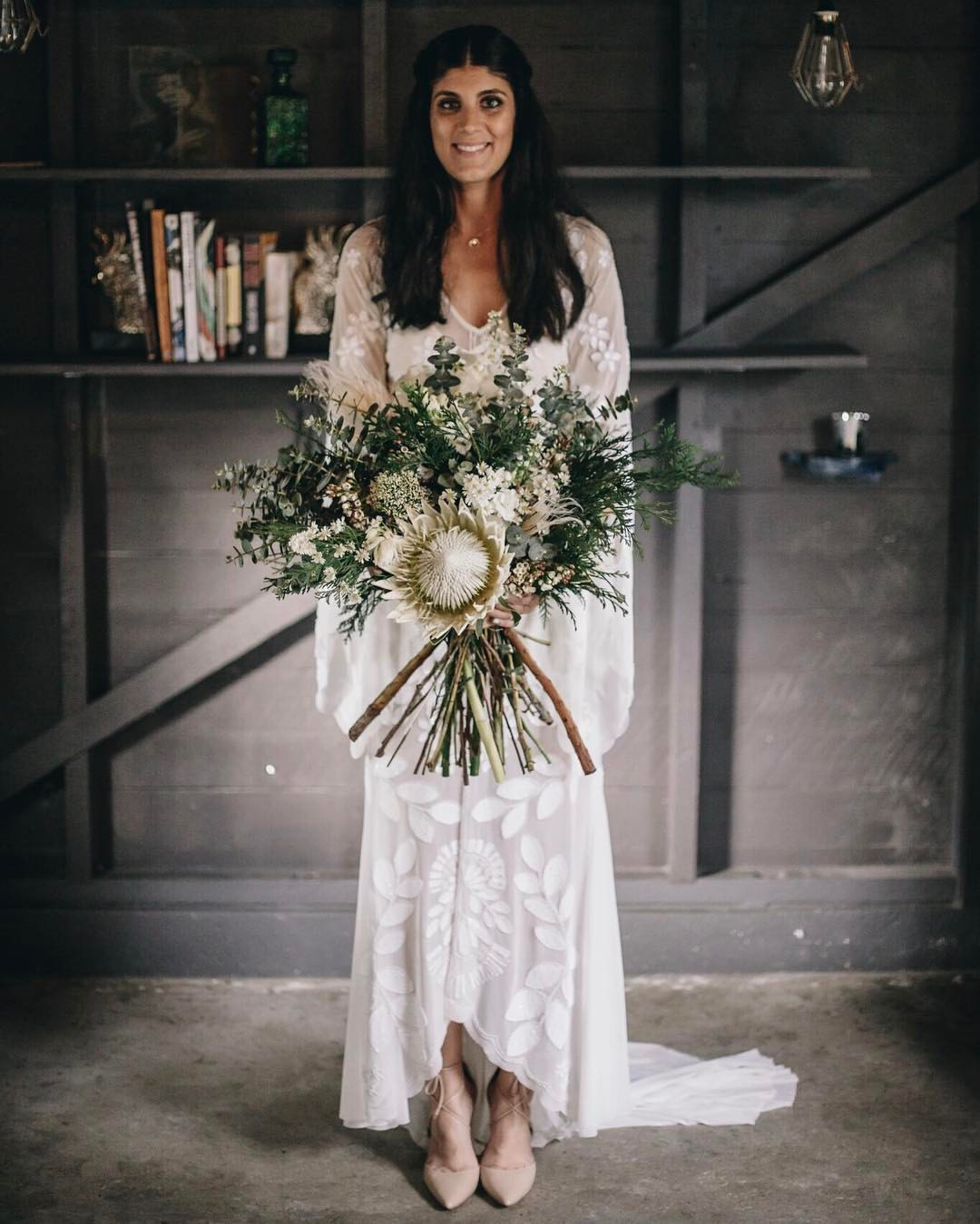 ness on her wedding day with flowers designed by her