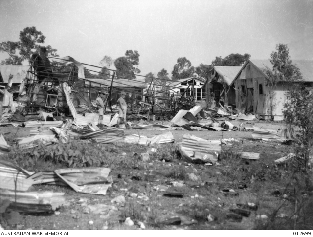 Soldiers inspecting damage to defence buildings following a bombing raid on Darwin, 012699