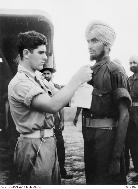 A Punjabi Sikh being processed at an Australian field ambulance after he was liberated by Americans at Los Negros in May 1944.