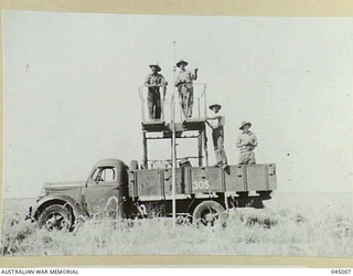 NO 4 MILITARY DISTRICT, AMF, SIGNALS PERSONNEL AND PMG LINESMEN WORKING ON THE OVERLAND TELEGRAPH LINE IN 1941 AT STURT PLAINS, NORTHERN TERRITORY