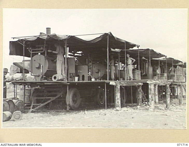 LAE, NEW GUINEA  1944-03-25  MACHINERY IN USE BY MEMBERS OF