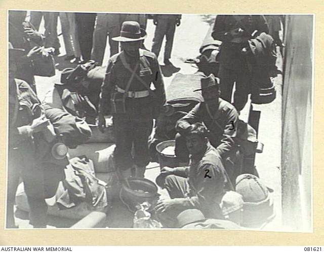 Men of the 1st Bahawalpur Infantry waiting to board SS City of Lincoln in Sydney in October 1944. These men had just refused a meal of curried meat that had not been prepared in accordance with their religious practice.