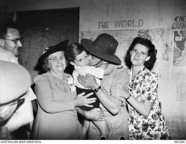 NX25641 Private (Pte) Albert George Denovan, of Sydney NSW, 2/3 Pioneer Battalion, a former prisoner of war (POW) is reunited with relatives at the showground.083286
