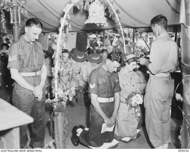 Corporal J. Rickards and Private E Townsend during their marriage ceremony.. 095030.