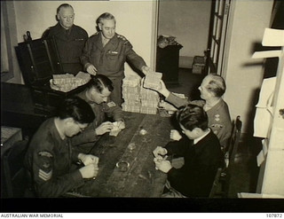 Kure, Japan. 1955-01-31. The pay section of HQ British Commonwealth Forces, Korea (BCFK), from time to time, withdraws British Armed Forces Special Vouchers (BAFSV's) from circulation because of ..