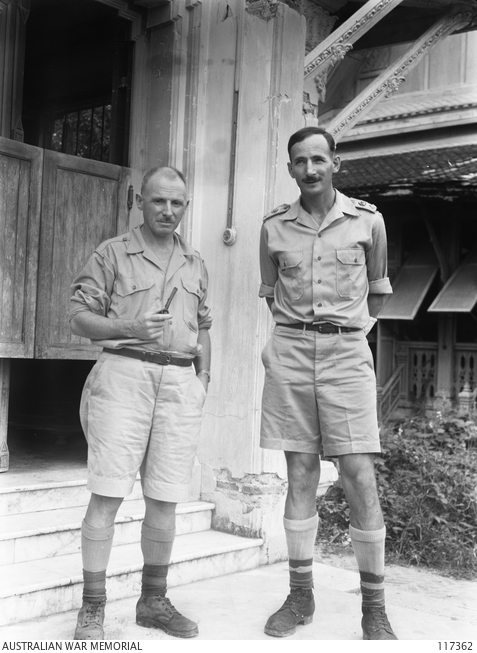 Lieutenant Colonel E.E.Dunlop (right) and Lieutenant Colonel A.E.Coates (left) outside their office at the medical headquarters in Bangkok, Thailand on 15 September 1945.