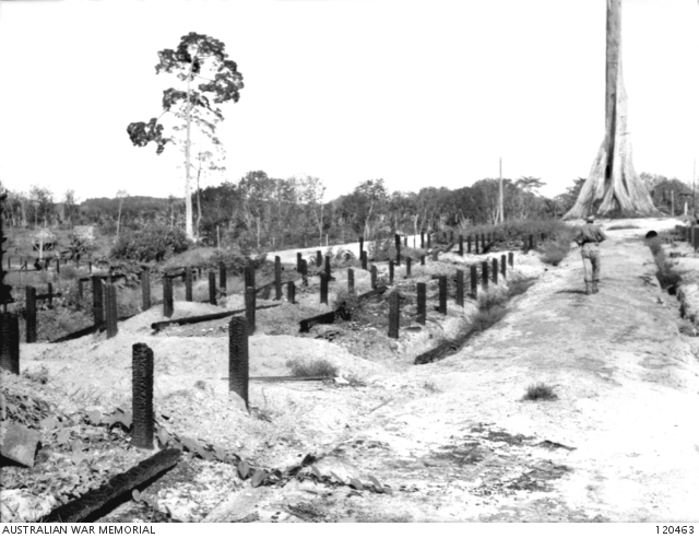 Pictured in October 1945, the burnt-out remains of a compound at Sandakan where the bodies of 300 murdered prisoners of war were discovered.