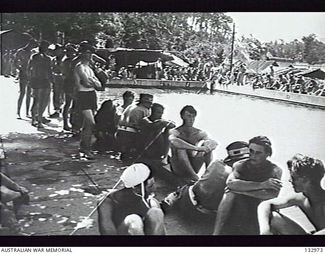 TROOPS FROM 65TH INFANTRY BATTALION RELAX AT A SWIMMING POOL AFTER