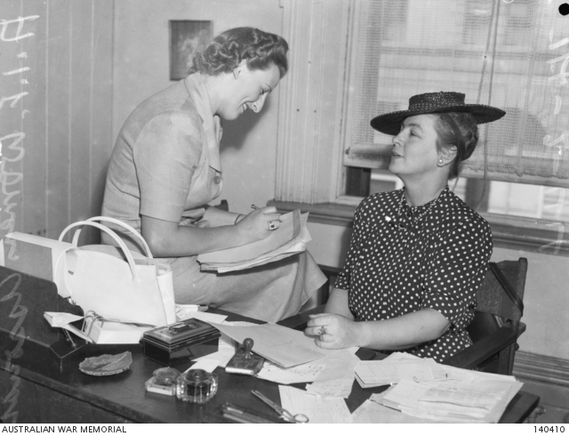 Melbourne, vic. 1944-02-14. Mrs g. Vasey (right) one of the convenors of the produce stall and mrs j. C. Mollard, convenor of the prisoner-of-war stall at the aif market fair to be held in the town hall on 1944-03-03. 140410.