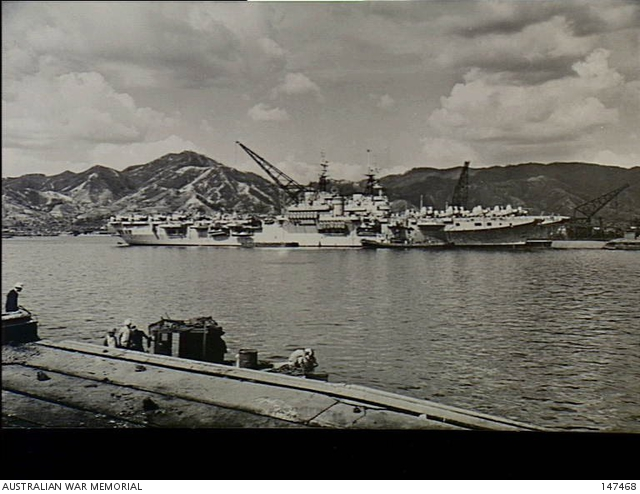 Kure, Japan  1951-09-29  Side view of HMAS Sydney berthed at