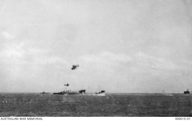 HMAS Australia and destroyer USS Perkins (visible beyond the cruiser) under Japanese air attack in the Coral Sea, 7 May 1942.