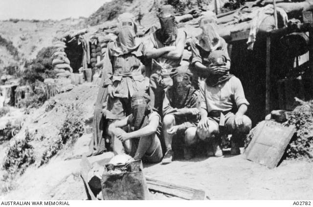 Six unidentified members of the 1st Divisional Signal Company wearing gas helmets. Gallipoli, c1915 (public domain)