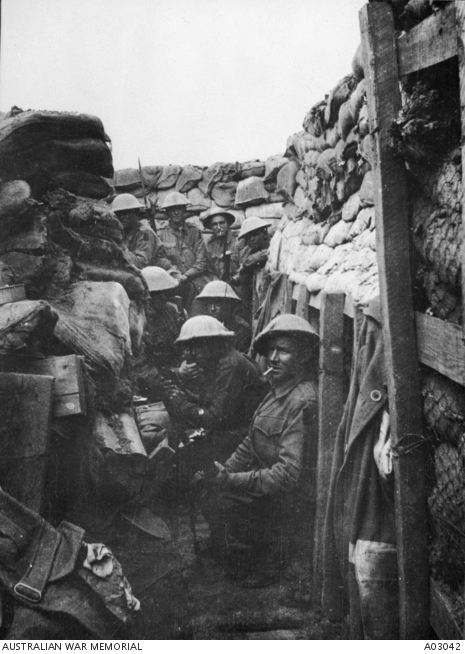 Men of the 53rd Battalion waiting to don their equipment for the attack at Fromelles. Only three of the men shown here came out of the action alive, and those three were wounded