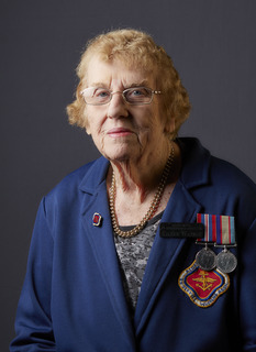 Studio portrait of QF270168 Eileen Watson (n. Richardson) who served during the Second World War.    'Reflections – Honouring Australian Second World War Veterans' is a project spanning from 2015 – ..