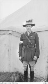 Portrait of Captain C T I Stinson MC Croix de Guerre, 2nd Australian Light Horse Signal Squadron. He is wearing a white armband, possibly because he is officer of the day