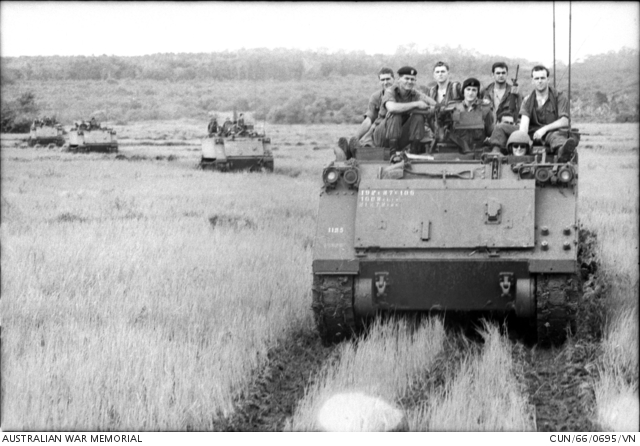 Troops from 6RAR return to Nui Dat from Long Tan on board 1 Squadron's APCs.