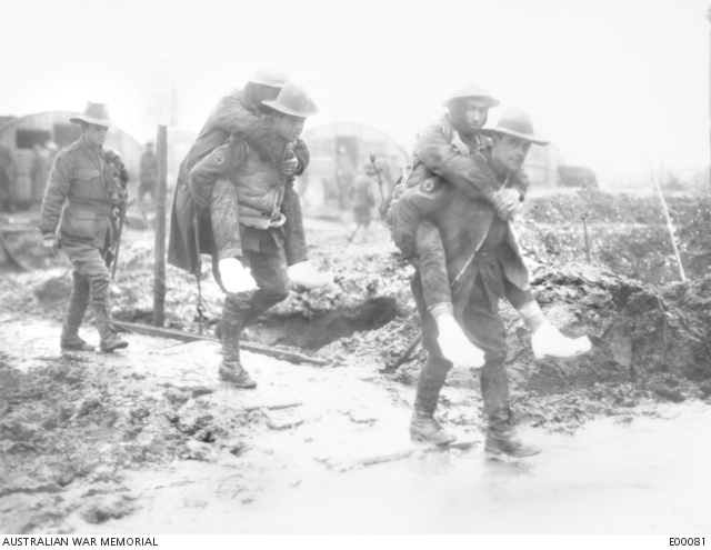 Captain C.E.W. Bean, knee-deep in mud in a trench near Gueudecourt. He was later to write and edit the multi-volume official history of Australians in the First World War.