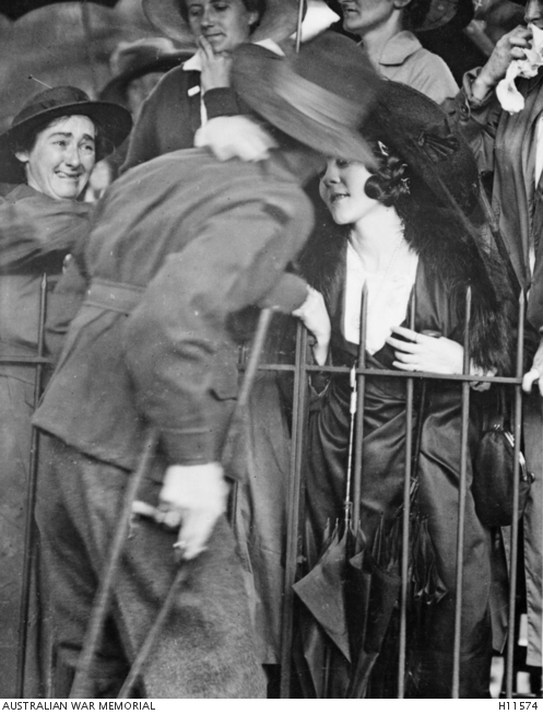 A wounded AIF soldier receives an affectionate welcome home at the Anzac Buffet in The Domain in Sydney.H11574.