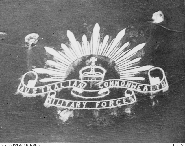 The Australian Rising Sun emblem cut in the side of a hill
