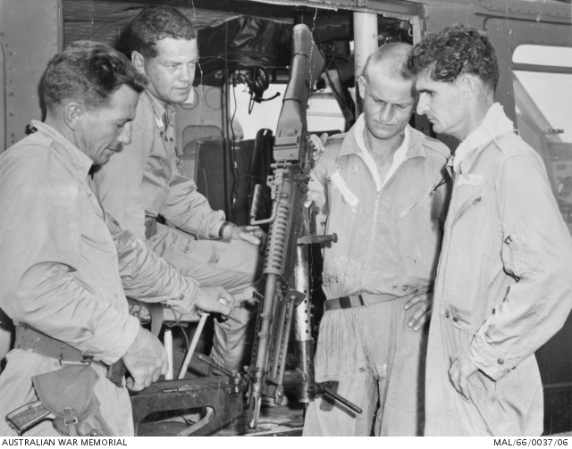 Crewmen of the RAAF Iroquois helicopters in Vietnam inspect