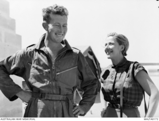 Kitty Bluett, star of the BBC radio show 'Ray's a Laugh', meets fighter pilot Squadron Leader John 'Bay' Adams DFC, AFC at the Malta base of 78 Fighter Wing RAAF.  Miss Bluett and her colleagues ..