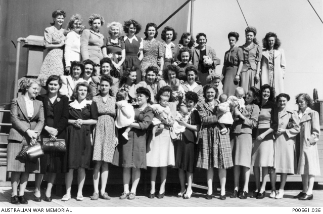 Probably Melbourne, Vic. C. 1945. Group portrait of Australian wives and babies of American soldiers leaving an Australian port for the United States. P00561.036.