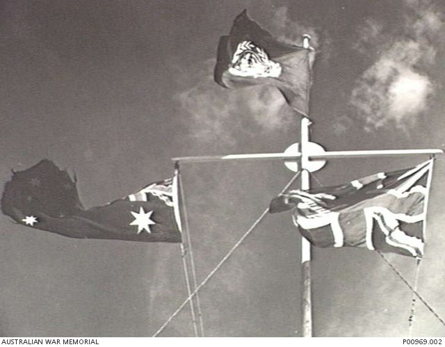 Camp Casey, South Korea, 1952. Flag pole flying the Australian flag, the Union Jack and the United Nations flag.