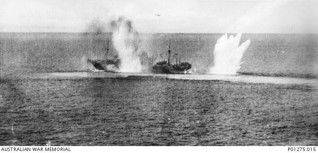 Battle of the Bismarck Sea, 3 March 1943: one of eight Japanese transports bound for Lae receives a direct hit, and a near miss by its stern.