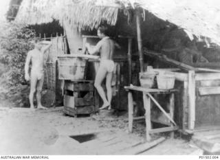 Kanchanaburi, Thailand. 1944. Kanchanaburi (Kanburi) is fifty kilometres north of Nong Pladuk (also known as Non Pladuk), or 364 kilometres south of Thanbyuzayat. Two prisoners of war clad only in ..