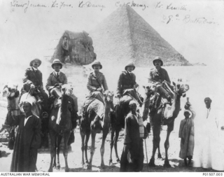EGYPT. 1915. FIVE OFFICERS OF THE 28TH BATTALION MOUNTED ON CAMELS IN FRONT OF THE SPHINX. LEFT TO RIGHT: 2ND LIEUTENANT ( 2 LT) FRANCIS ERNEST JENSEN, DIED OF WOUNDS ON GALLIPOLI 1915-09-13; ..