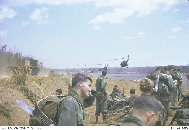 Soldiers of the 7th Battalion, Royal Australian Regiment (7RAR), wait for the helicopters that will take them to the starting point for Operation Coburg.