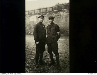 Outdoor portrait of two Australian Prisoners of War (POW) at German POW Camp Stuttgart, Germany. Identified on the left is 3157 Private (Pte) Walter Henry Wood, from Nebo via Mackay, Qld and ..