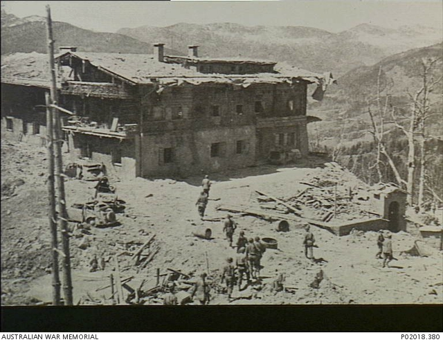 Only days after the bombing, American and French troops outside the former Hotel Zum Türken, Obersalzberg, which served as a headquarters for the Sicherheitsdienst. It was one of several buildings at the Nazi complex at Obersalzberg. P02018.380