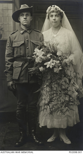 London, England. c. 1917. Wedding portrait of 218 Temporary Staff Sergeant Henry (Harry) William Freeman and his English bride Dorothy (nee Wilson) after their marriage at Islington. P02098.001.