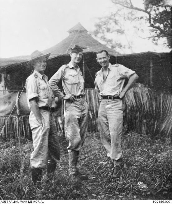 Goodeenough Island, New Guinea, 1943. Left to right: Clement Seale (Australian soldier artist), Robert Emerson Curtis (camouflage officer attached to the RAAF) and Max Dupain (photographer) outside their hut.