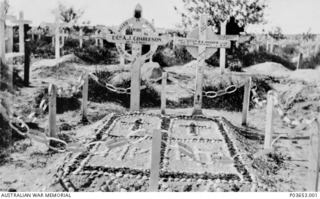 The graves of 1119 Lance Corporal (LCpl) Allan John Charleston (left) and 1318 LCpl Ralph Ernest Disher, with their original wooden crosses and marked out in stones. Both of the 10th Light Horse ..