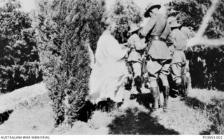 The Padre and Colonel Scott stand talking with other members of the Regiment following the burial of 140 Sergeant (Sgt) Albert Edward Jones, A Squadron, 9th Light Horse Regiment. Sgt Jones, of ..