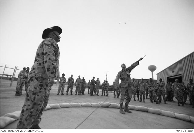 Australian Corporal Trevor Hollis looks on a United States