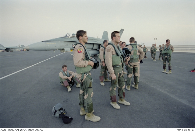 Pilots from 75 Squadron RAAF are welcomed back to Al Udeid airbase by Group  Captain William ... | Australian War Memorial