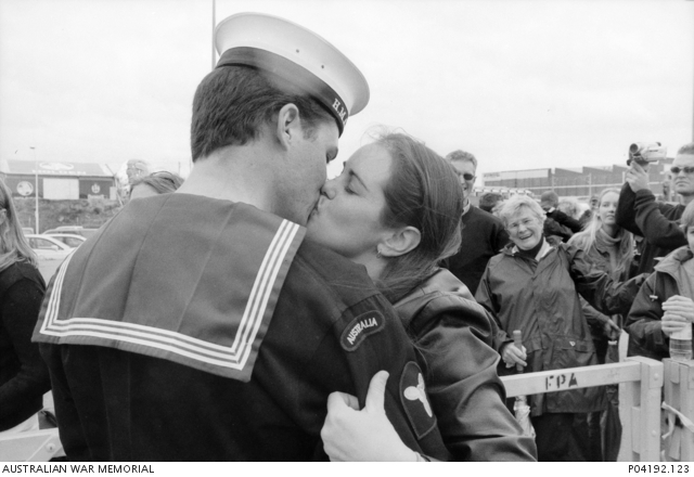 An unidentified marine technician from HMAS Darwin kisses his girlfriend at a homecoming ceremony for HMAS ANZAC and HMAS Darwin at Victoria Quay, Fremantle, WA.
