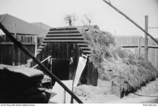 The baffle box of an Anderson air raid shelter under construction in the back yard of the Adams family home at 405 Gardeners Road, Mascot, Sydney