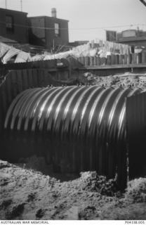 An Anderson air raid shelter under construction in the back yard of the Adams family home at 405 Gardeners Road, Mascot, Sydney