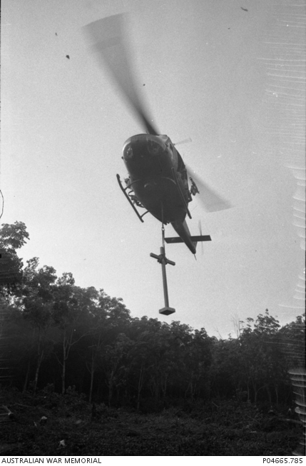 The Long Tan cross is flown in by helicopter.