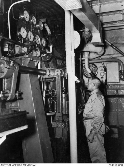 Army Tug Engine Room: An Unidentified Crew Member Works In The Engine Room Of