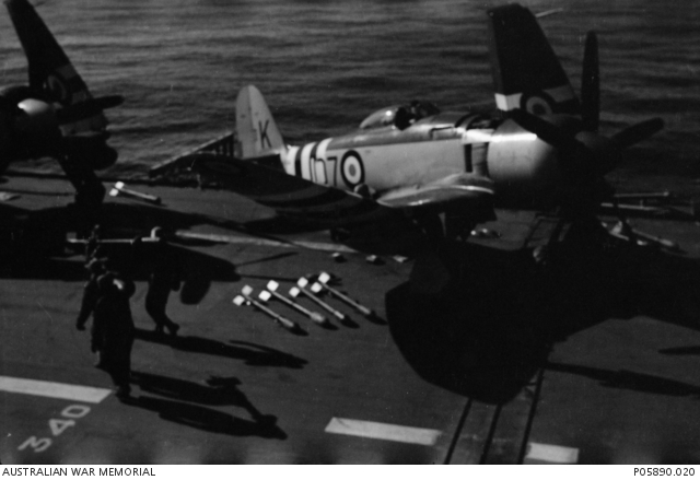 a hawker sea fury fb 11 fighter aircraft on the deck of