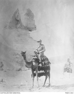 Portrait of 88 Private (Pte) Bertram Edward Hoult, 26th Battalion sitting on a camel in front of The Sphinx. Pte Hoult, a sawyer or timber worker fron Nanango, Queensland, enlisted on 1 February ..