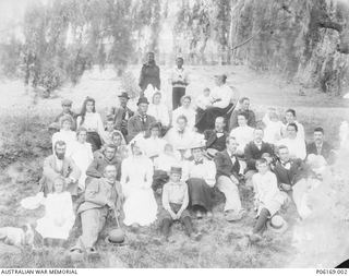 Group portrait of family at a picnic near the Toise River in South Africa